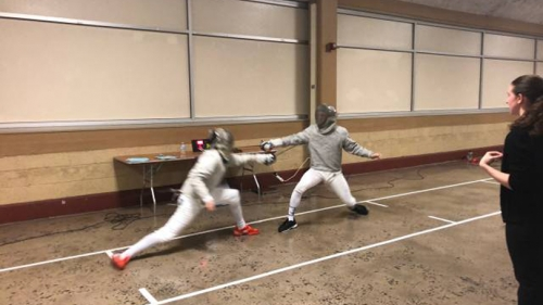 Two fencers compete.