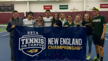 The Tennis Team poses with their regional championship banner.