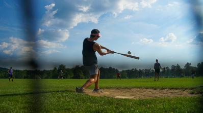 A baseball player swings a bat.
