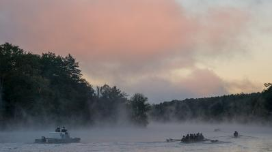 Rowers on the Connecticut River in the morning fog.