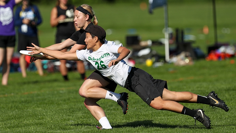 Caitlyn Lee, No. 26, dives for the Frisbee at the USA Ultimate DI Championships.