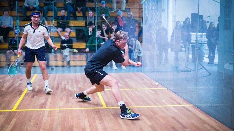 Squash players play a game.