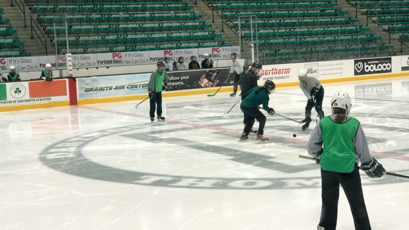 IM Hockey participants playing in a game at Thompson Arena
