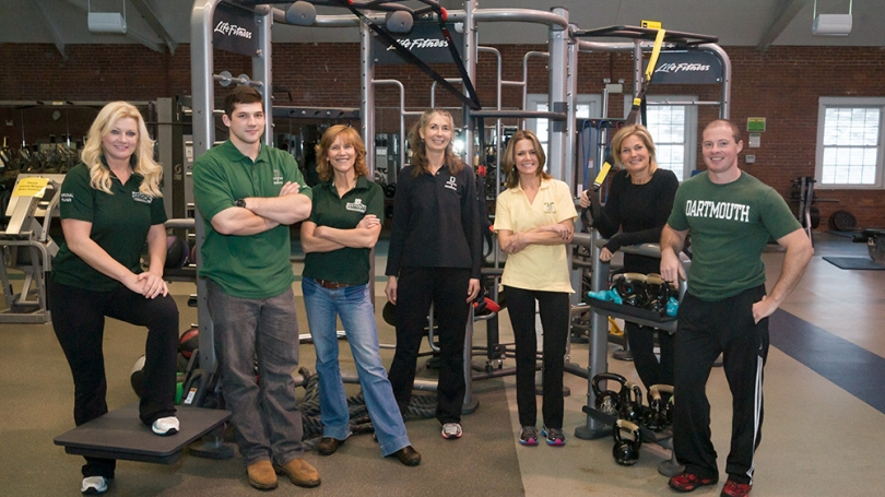 Dartmouth's trainers pose for a picture in the gym.