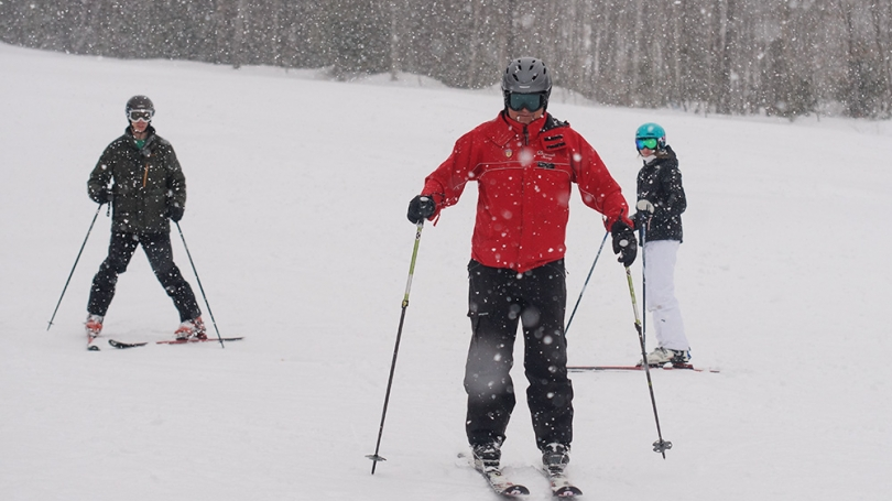 Skiers during a snow storm.